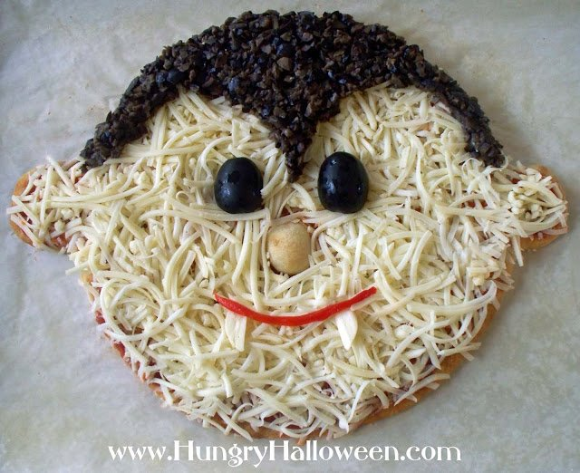 This Halloween Pizza Vampire will be a great addition to your party! It's so delicious all of your family and friends will be dying to sink their fangs into it!