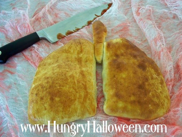Looking for a gross and creepy appetizer to make? These Lung Calzones are the perfect party food! Filled with delicious madeira mushroom you wont be able to get enough!