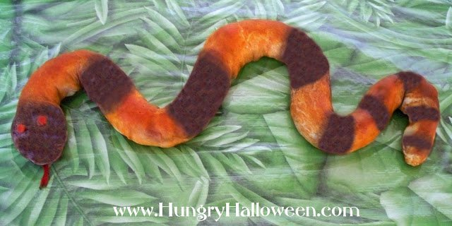 This Slithering Snake Snack will have everyone in awe! This deliciously strange pigs in a blanket is the perfect appetizer for your Halloween Party!