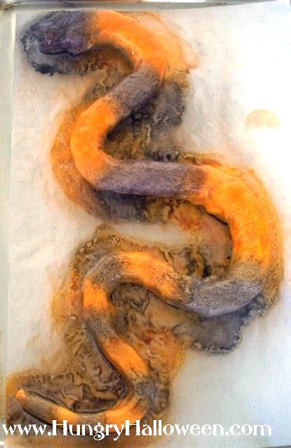 spray the crescent dough snake with orange and black food coloring spray