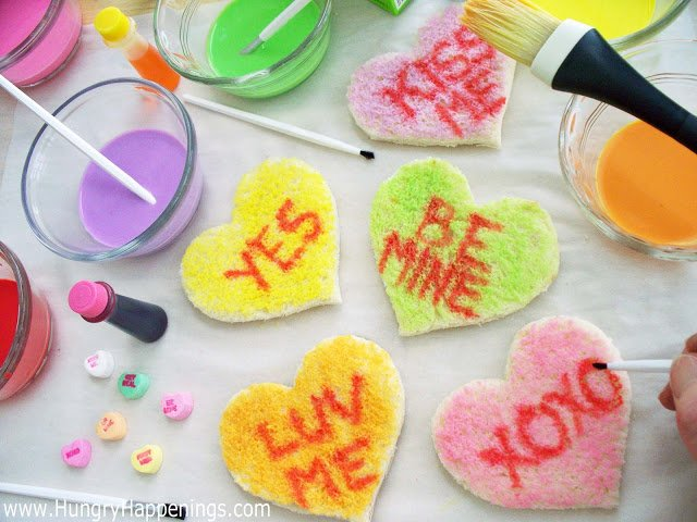 use red food coloring to write messages onto conversation heart toast