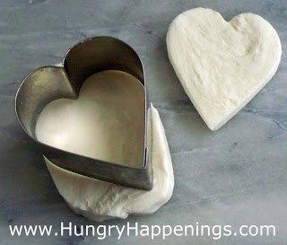 cut mozzarella cheese using a heart-shaped cookie cutter