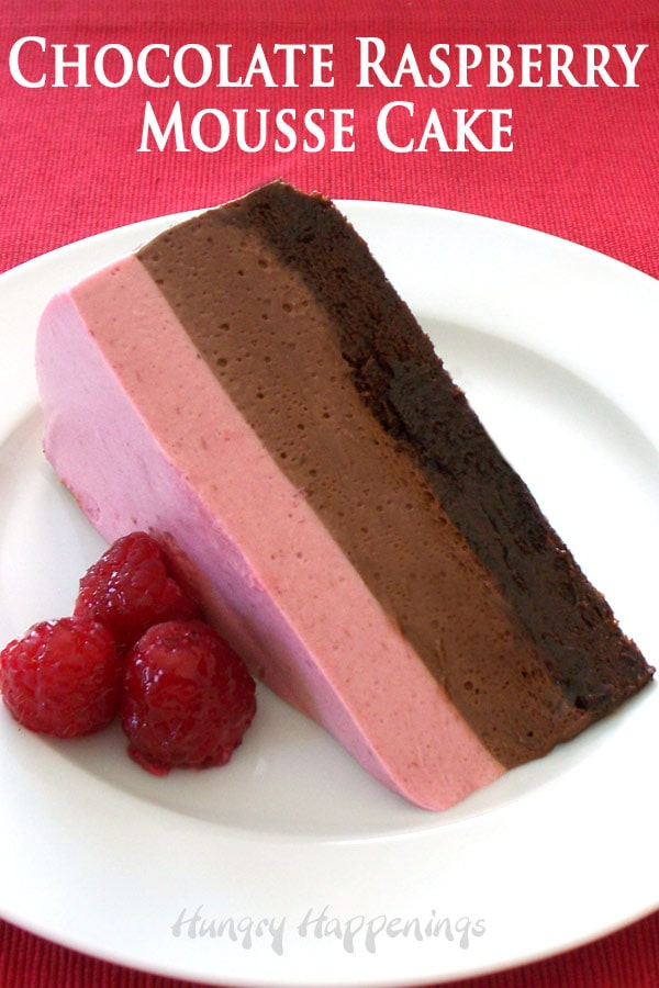 3-layer raspberry and chocolate mousse cake on a flourless chocolate cake