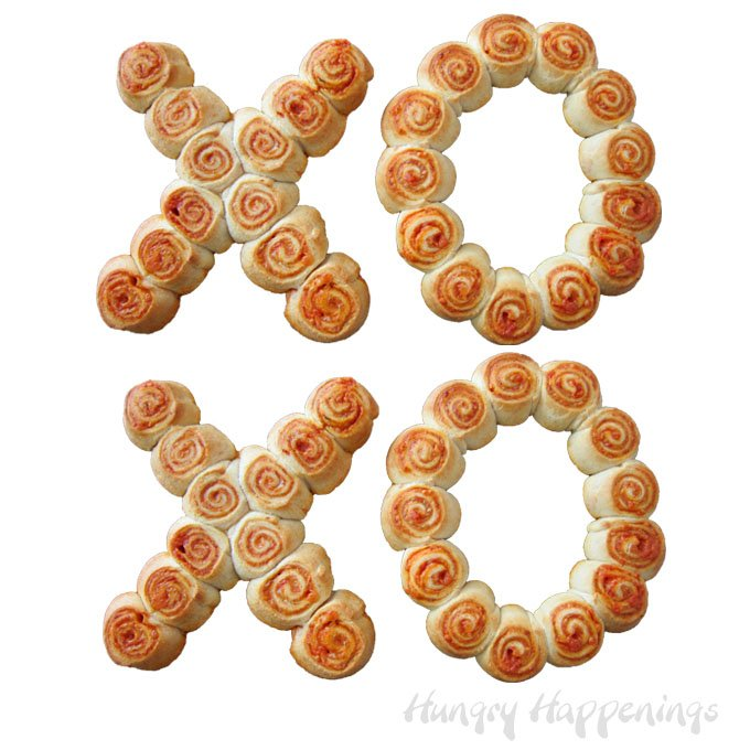 This Valentine's Day, show someone how much you love them by giving them Hugs and Kisses Pizza Pinwheels for dinner. The pepperoni filled pinwheels are simple to make in the shape of X's and O's for this love filled holiday.