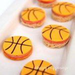 basketball cheese slices served on crackers or bread with round pieces of ham