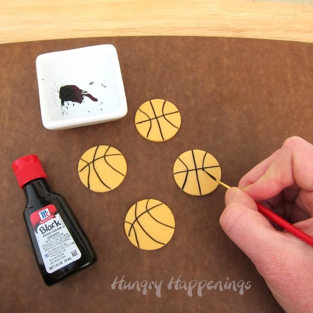 painting lines using black food coloring to make basketball cheese slices