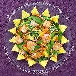 Pan Seared Shrimp spinach salad topped with sugar snap peas, carrots, pineapple, and chow mein noodles tossed with ginger dressing.