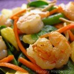 sauteed shrimp served on a bed of baby spinach with carrots, pineapple, sugar snap peas, and chow mein noodles