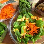 toss together shredded carrots, sugar snap peas, pineapple, and baby spinach with ginger dressing