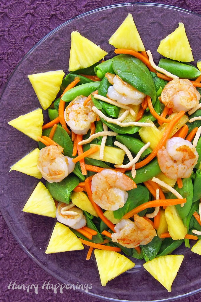 Shrimp salad topped with pan-seared shrimp, pineapple, sugar snap peas, and carrots topped with ginger dressing.