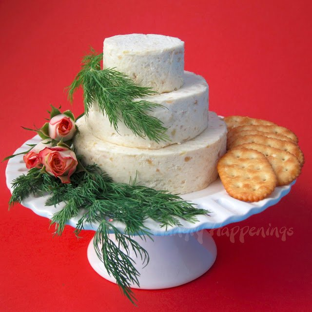 cheese ball wedding cake with fresh dill and roses