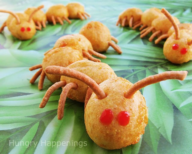 Craft caterpillars out of mini corn dogs and chow mein noodles.