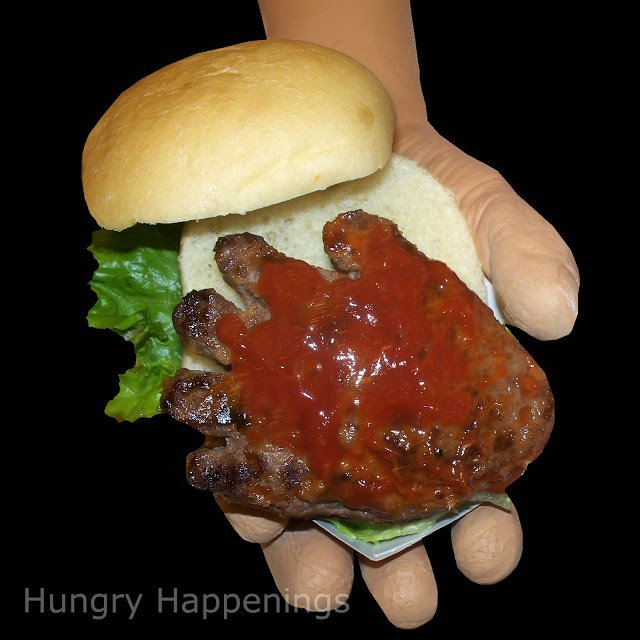 Make a simple burger into this scary Hand-Burgers Dripping with Blood! They're the perfect dinner idea to spook your kids...just wait to see their faces!