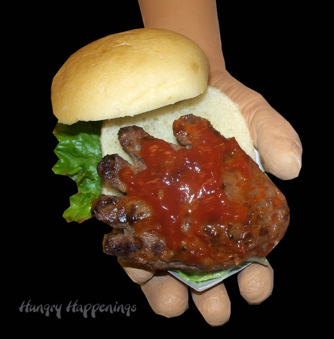 Hand-burgers dripping with blood red ketchup. Gross Halloween Food Ideas.