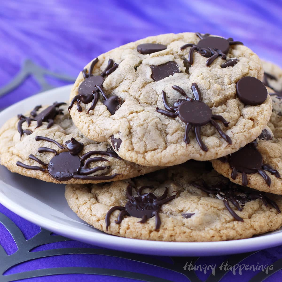 Spider chocolate chip cookies infested with chocolate spiders.