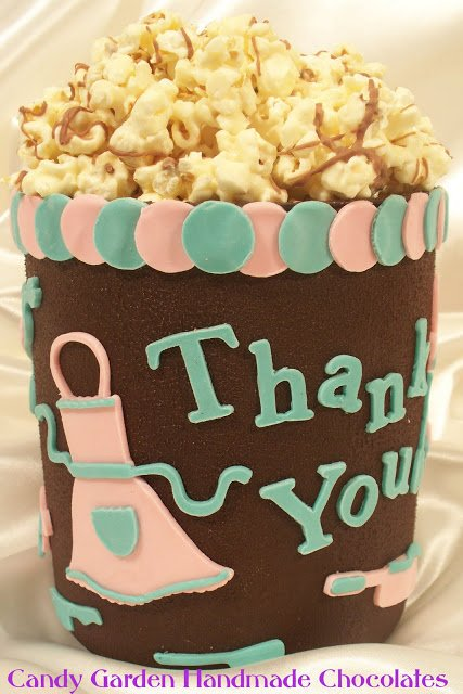 Chocolate bucket filled with white chocolate popcorn.