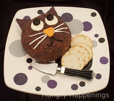 Make your usual cheese ball into this fun Black Cat Cheese Ball! Everyone loves a cheese ball for a party appetizer so take it to a whole new level of delicious!