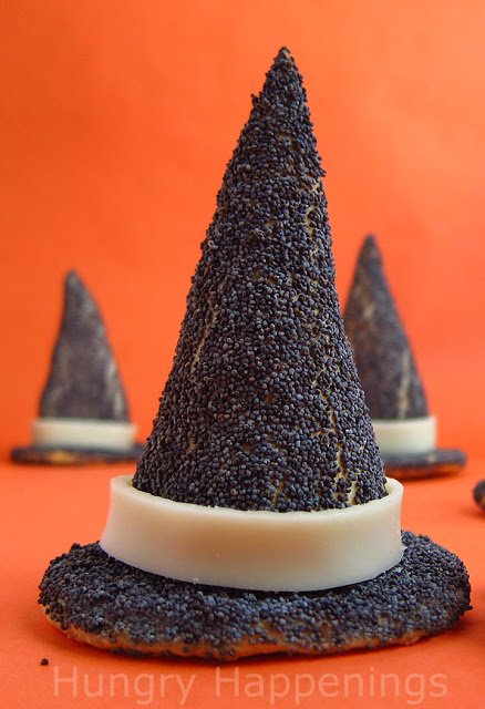 Hop on your broom and fly to the kitchen to cook up these Crescent Roll Witch Hats! They're so simple to make and make an amazing appetizer for your spooky party!
