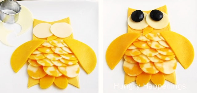 cut wings from cheddar cheese and eyes from white cheddar cheese then attach them to the owl and add black olive pupils.