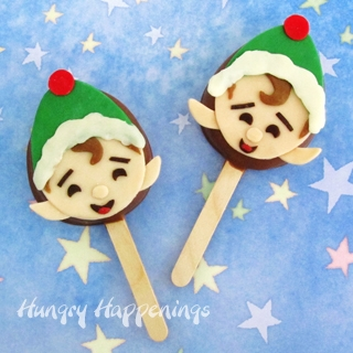 Christmas Elf Lollipops decorated with a modeling chocolate topper.