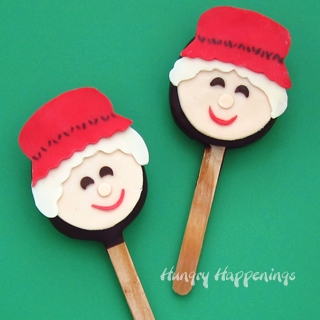 Chocolate Truffle Mrs. Claus Lollipops are decorated with a modeling chocolate topper.