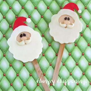 Santa Claus Lollipops decorated with a modeling chocolate topper.
