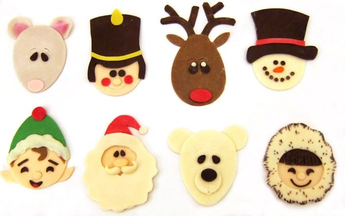 Craft modeling chocolate decorations to create cute Christmas treats.