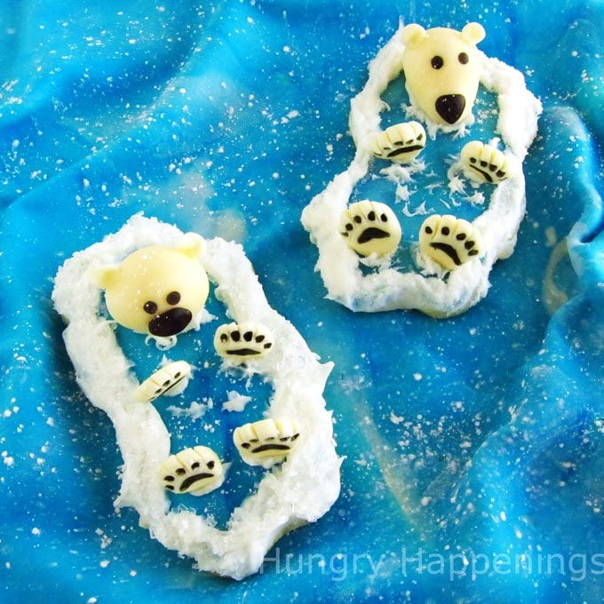 Adorably cute polar bear cookies are decorated using modeling chocolate. See the step-by-step tutorial at HungryHappenings.com.