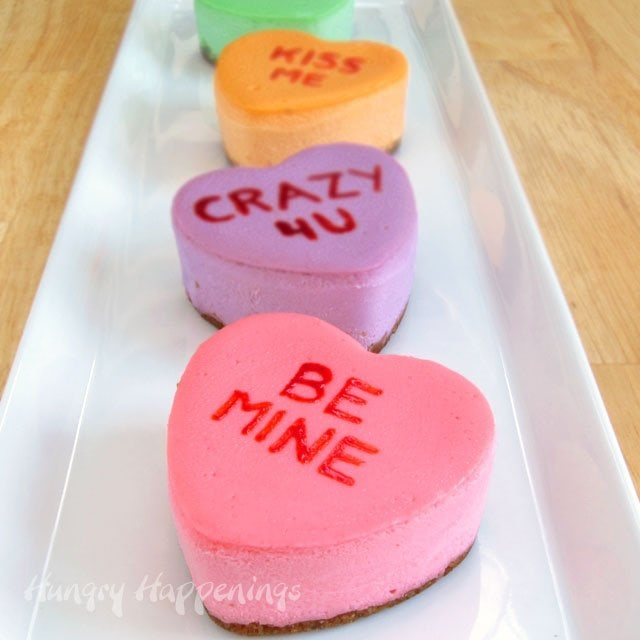 Check out the recipe to make these sweet little Conversation Heart Cheesecakes at HungryHappenings.com