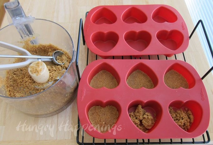 Use a silicone heart mold to create heart shaped cheesecakes for Valentine's Day.