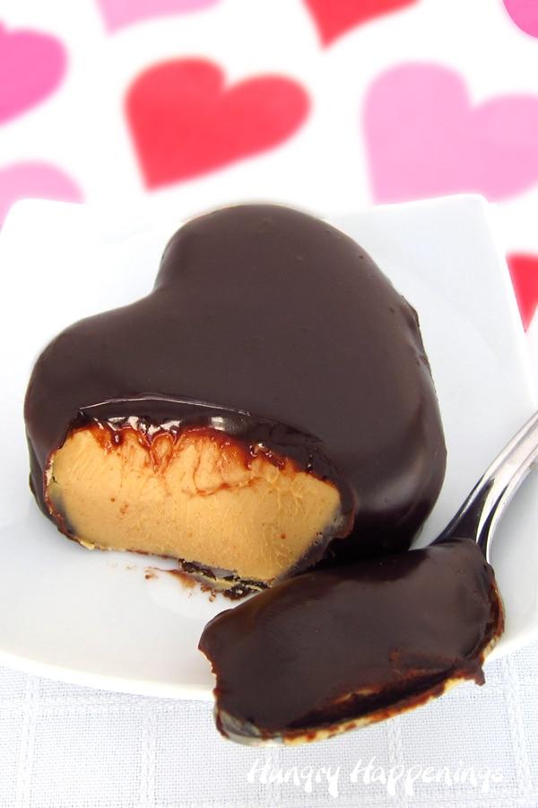 Peanut butter fudge filled heart coated in creamy chocolate ganache