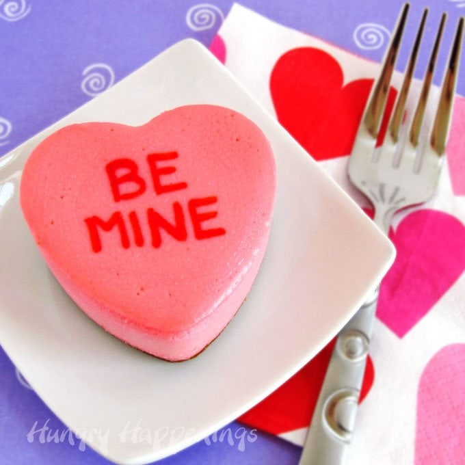 Add personalized messages to your own homemade Conversation Heart Cheesecakes to serve at Valentine's Day.