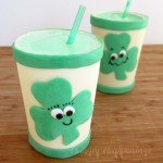 Edible white chocolate cups filled with Shamrock Shakes flavored with mint.