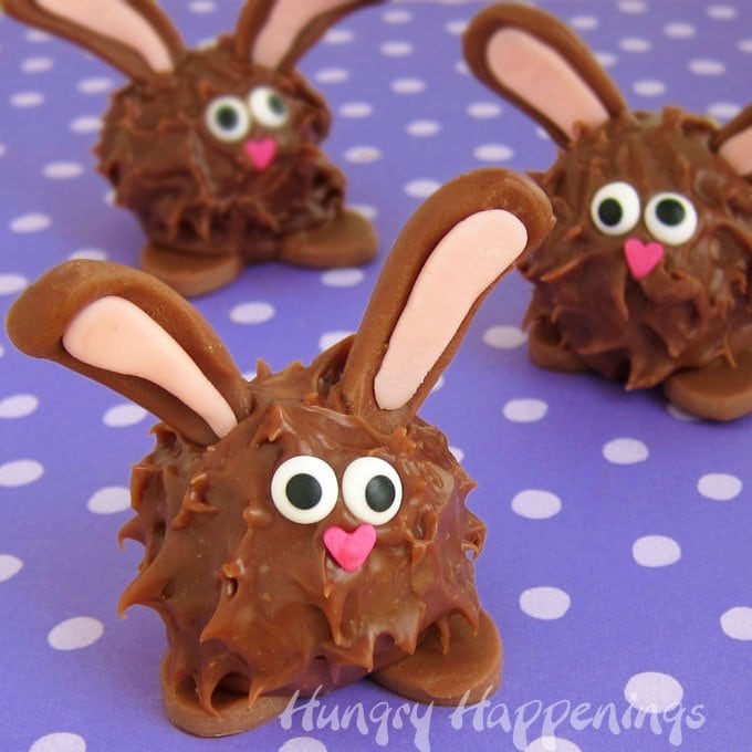 Peanut Butter Fudge Filled Chocolate Easter Bunnies couldn't be cuter. Each chubby little Easter treat is coated in milk chocolate ganache and is decorated with chocolate ears and feet.
