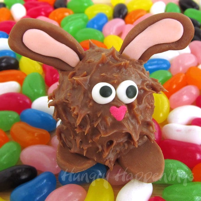 Adorably cute Peanut Butter Fudge Filled Chocolate Easter Bunnies are coated in milk chocolate ganache and decorated with chocolate ears.