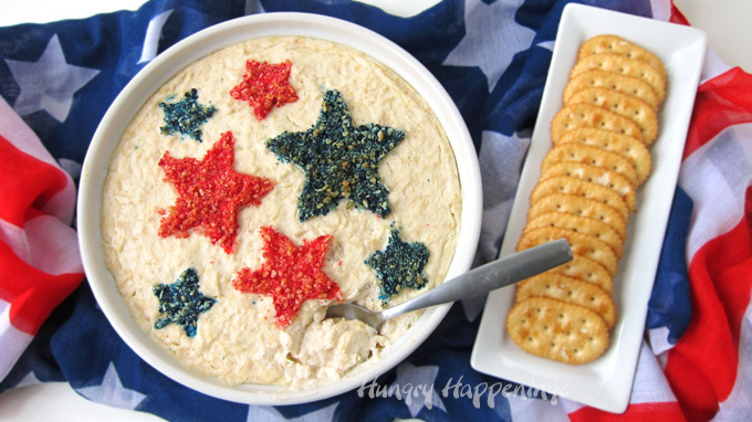 Red, white, and blue chicken dip topped with stars makes a fun 4th of July appetizer.