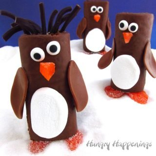 Turn store bought treats into adorably cute Snack Cake Penguins. They are super fun treats for kids.