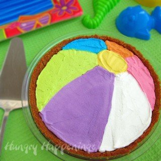 Decorate a pie to look like a beach ball using colored whipped topping.