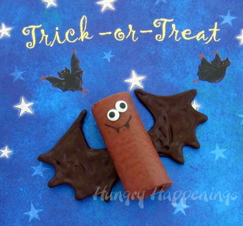 Chocolate Snack Cake Bats set on Halloween scrapbook paper.