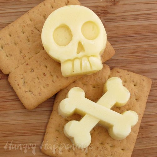 Turn your normal block of cheese into this Skull and Crossbones Mozzarella Cheese Shapes! This simple snack is easy to make yet deathly delicious!