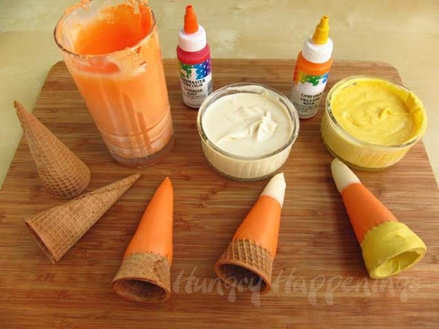 These Candy Corn Cones are an easy Halloween treat to make! They're a perfect last minute treat for your Halloween party and can be filled with whatever you like!