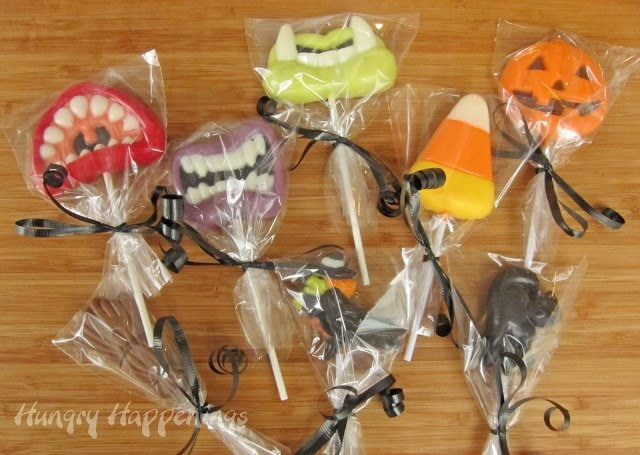 Homemade Halloween candies. Monster teeth, candy corn, pumpkins, witch, black cat, and witch's broom lollipops.