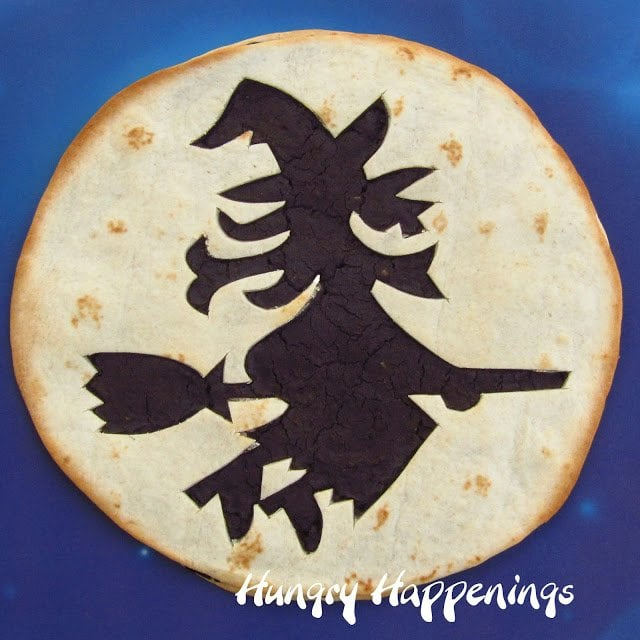 Put those pumpkin carvers to use in another way and make this Halloween Tortilla Appetizer Decorated Using Pumpkin Carving Stencils! Make these delicious tortillas and fill them with anything you like and add any spooky design you want!