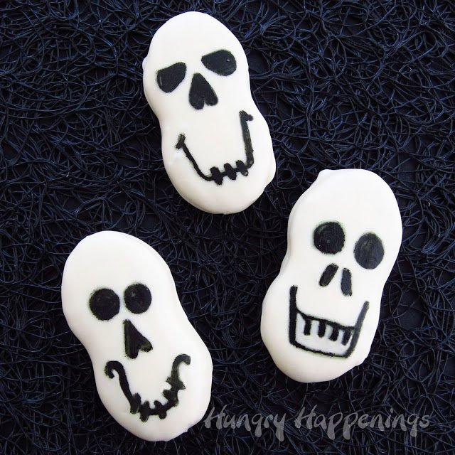 Looking for Quick and Easy Halloween Treats? These Nutter Butter Skulls are a last minute snack you can make for your Halloween party! They are spooky and delicious, the best of both worlds!