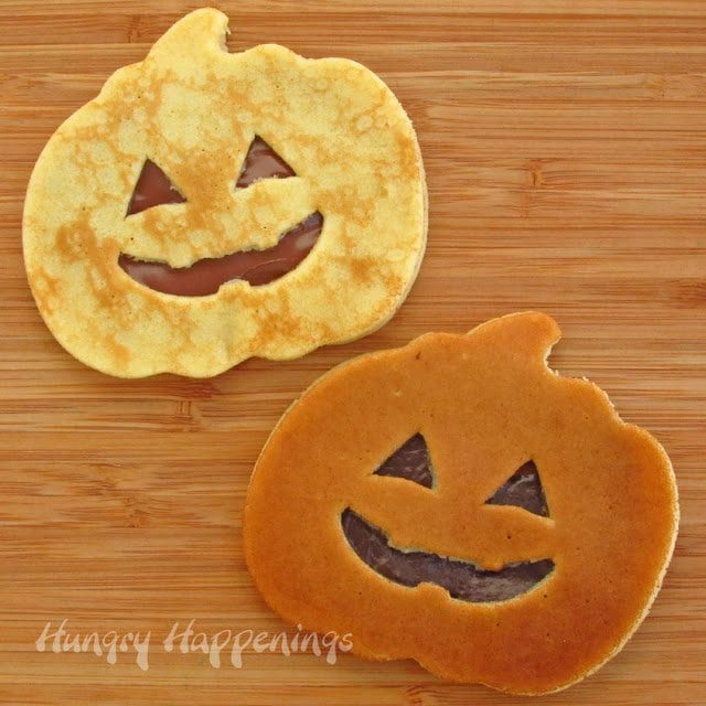 Wake up on Halloween to a spooky Halloween Breakfast with these Jack-O-Lantern and Spider Web Pancakes! These treats have a delicious surprise inside that will have your kids begging for more!