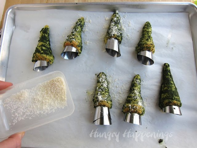 Sprinkle Parmesan cheese over top of the Green Pesto Crescent Roll Christmas Trees
