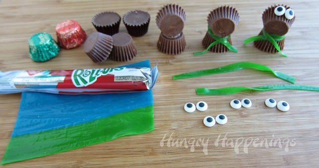 Reese's Cup miniatures, candy eyes, and fruit rolls, attached to create reindeer