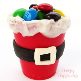 Add a touch of whimsy to your Christmas treats this holiday by making Edible Santa Suit Candy Cups. You can fill them with candies, pudding, chocolate mousse, or nuts.