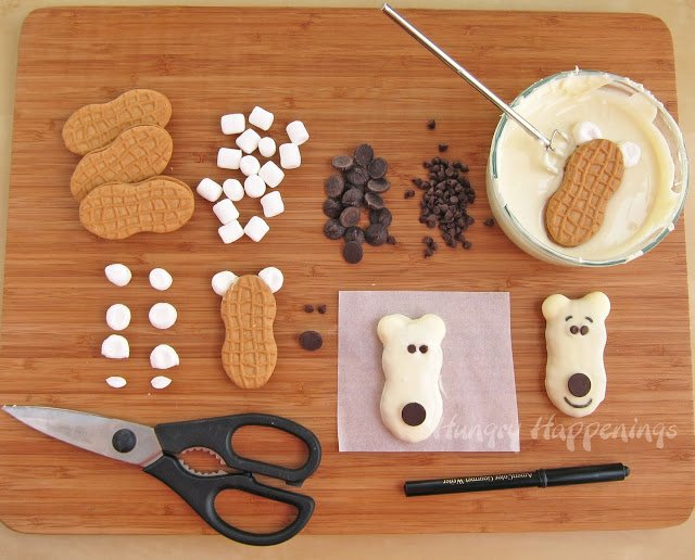 Transform a plain store bought cookie into a festive little treat! Make these Nutter Butter Polar Bear Cookies and your guests will be growling for you to whip up another batch!