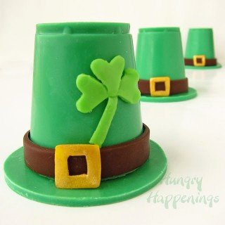 Leprechaun Hat's made out of green candy melts and modeling chocolate filled with candy for St. Patrick's Day.